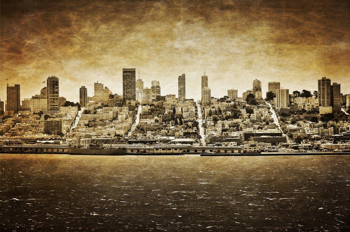 Постер Сан-Франциско Сан-Франциско винтажный вид из АлькатрасаСан-Франциско<br>Постер на холсте или бумаге. Любого нужного вам размера. В раме или без. Подвес в комплекте. Трехслойная надежная упаковка. Доставим в любую точку России. Вам осталось только повесить картину на стену!<br>