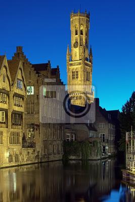 Постер Брюгге Вечерний вид из башни Бельфор в Брюгге, БельгияБрюгге<br>Постер на холсте или бумаге. Любого нужного вам размера. В раме или без. Подвес в комплекте. Трехслойная надежная упаковка. Доставим в любую точку России. Вам осталось только повесить картину на стену!<br>