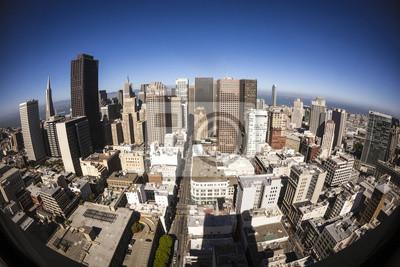 Постер Сан-Франциско Небоскребы в центре Сан-Франциско в конце дняСан-Франциско<br>Постер на холсте или бумаге. Любого нужного вам размера. В раме или без. Подвес в комплекте. Трехслойная надежная упаковка. Доставим в любую точку России. Вам осталось только повесить картину на стену!<br>