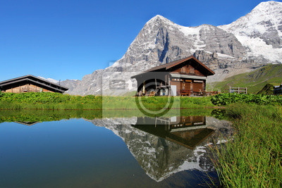 Постер Альпийский пейзаж Шале и Горы Айгер, ШвейцарияАльпийский пейзаж<br>Постер на холсте или бумаге. Любого нужного вам размера. В раме или без. Подвес в комплекте. Трехслойная надежная упаковка. Доставим в любую точку России. Вам осталось только повесить картину на стену!<br>
