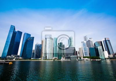 Постер Сингапур Небоскребы делового района СингапураСингапур<br>Постер на холсте или бумаге. Любого нужного вам размера. В раме или без. Подвес в комплекте. Трехслойная надежная упаковка. Доставим в любую точку России. Вам осталось только повесить картину на стену!<br>