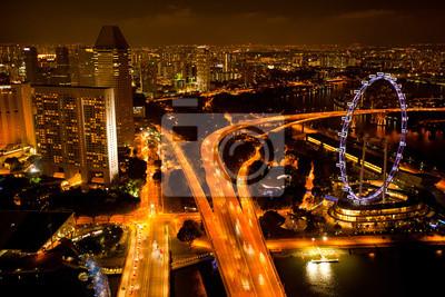 Постер Сингапур Панорама Сингапур с крыши Marina Bay отель, в ночиСингапур<br>Постер на холсте или бумаге. Любого нужного вам размера. В раме или без. Подвес в комплекте. Трехслойная надежная упаковка. Доставим в любую точку России. Вам осталось только повесить картину на стену!<br>