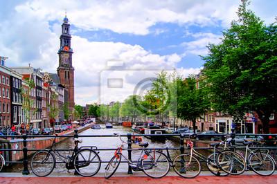 Постер Нидерланды Велосипеды прокладки моста через каналы АмстердамаНидерланды<br>Постер на холсте или бумаге. Любого нужного вам размера. В раме или без. Подвес в комплекте. Трехслойная надежная упаковка. Доставим в любую точку России. Вам осталось только повесить картину на стену!<br>