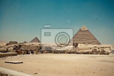 Постер Архитектура Постер 43381382, 30x20 см, на бумагеЕгипетские пирамиды<br>Постер на холсте или бумаге. Любого нужного вам размера. В раме или без. Подвес в комплекте. Трехслойная надежная упаковка. Доставим в любую точку России. Вам осталось только повесить картину на стену!<br>