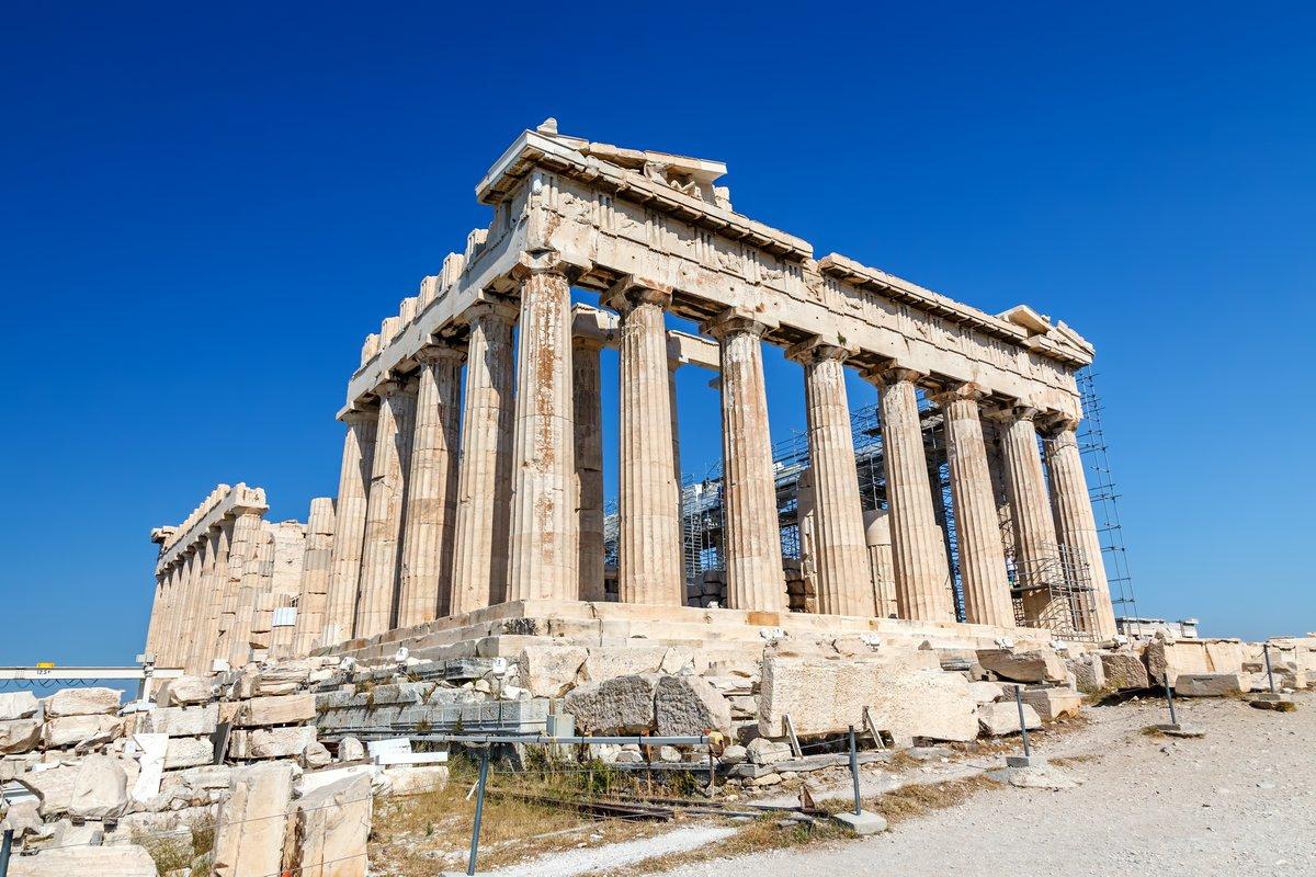 Постер Греция Парфенон в Акрополь, АфиныГреция<br>Постер на холсте или бумаге. Любого нужного вам размера. В раме или без. Подвес в комплекте. Трехслойная надежная упаковка. Доставим в любую точку России. Вам осталось только повесить картину на стену!<br>