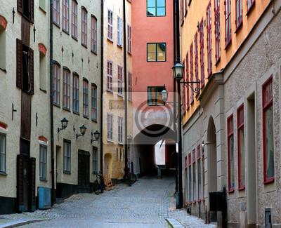 Постер Стокгольм Узкой улице в СтокгольмеСтокгольм<br>Постер на холсте или бумаге. Любого нужного вам размера. В раме или без. Подвес в комплекте. Трехслойная надежная упаковка. Доставим в любую точку России. Вам осталось только повесить картину на стену!<br>