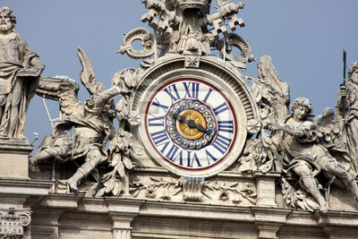 Постер Ватикан Часы на фасад базилики Святого Петра. Рим, ИталияВатикан<br>Постер на холсте или бумаге. Любого нужного вам размера. В раме или без. Подвес в комплекте. Трехслойная надежная упаковка. Доставим в любую точку России. Вам осталось только повесить картину на стену!<br>