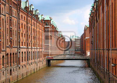 Постер Гамбург Speicherstadt склад районе Гамбург, ГерманияГамбург<br>Постер на холсте или бумаге. Любого нужного вам размера. В раме или без. Подвес в комплекте. Трехслойная надежная упаковка. Доставим в любую точку России. Вам осталось только повесить картину на стену!<br>