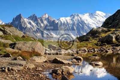 Постер Альпийский пейзаж Монблан, ФранцияАльпийский пейзаж<br>Постер на холсте или бумаге. Любого нужного вам размера. В раме или без. Подвес в комплекте. Трехслойная надежная упаковка. Доставим в любую точку России. Вам осталось только повесить картину на стену!<br>