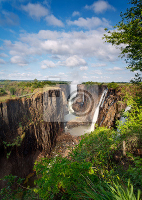 Постер Африканский пейзаж Водопад Виктория, ЗамбияАфриканский пейзаж<br>Постер на холсте или бумаге. Любого нужного вам размера. В раме или без. Подвес в комплекте. Трехслойная надежная упаковка. Доставим в любую точку России. Вам осталось только повесить картину на стену!<br>
