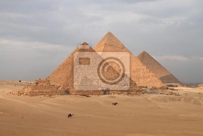 Постер Архитектура Постер 44663875, 30x20 см, на бумагеЕгипетские пирамиды<br>Постер на холсте или бумаге. Любого нужного вам размера. В раме или без. Подвес в комплекте. Трехслойная надежная упаковка. Доставим в любую точку России. Вам осталось только повесить картину на стену!<br>