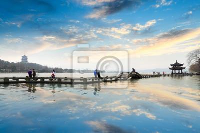 Постер Китай Hangzhou west lake на послесвечениеКитай<br>Постер на холсте или бумаге. Любого нужного вам размера. В раме или без. Подвес в комплекте. Трехслойная надежная упаковка. Доставим в любую точку России. Вам осталось только повесить картину на стену!<br>