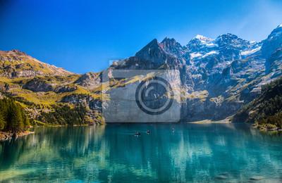 Постер Альпийский пейзаж Озеро Oeschinen, Kandersteg, ШвейцарияАльпийский пейзаж<br>Постер на холсте или бумаге. Любого нужного вам размера. В раме или без. Подвес в комплекте. Трехслойная надежная упаковка. Доставим в любую точку России. Вам осталось только повесить картину на стену!<br>