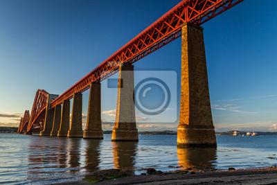 Постер Шотландия Сталь железнодорожный мост через реку в ШотландииШотландия<br>Постер на холсте или бумаге. Любого нужного вам размера. В раме или без. Подвес в комплекте. Трехслойная надежная упаковка. Доставим в любую точку России. Вам осталось только повесить картину на стену!<br>
