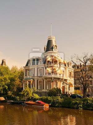 Постер Амстердам Типичная Амстердамская АрхитектураАмстердам<br>Постер на холсте или бумаге. Любого нужного вам размера. В раме или без. Подвес в комплекте. Трехслойная надежная упаковка. Доставим в любую точку России. Вам осталось только повесить картину на стену!<br>