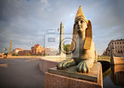 Постер Архитектура Сфинкс Химера на египетском Мосту в Санкт-Петербурге, 28x20 см, на бумагеСфинксы<br>Постер на холсте или бумаге. Любого нужного вам размера. В раме или без. Подвес в комплекте. Трехслойная надежная упаковка. Доставим в любую точку России. Вам осталось только повесить картину на стену!<br>