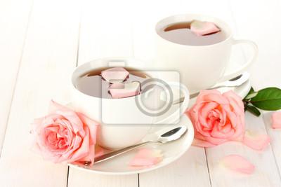 Постер Розы Чашки чая с розами на белый деревянный столРозы<br>Постер на холсте или бумаге. Любого нужного вам размера. В раме или без. Подвес в комплекте. Трехслойная надежная упаковка. Доставим в любую точку России. Вам осталось только повесить картину на стену!<br>