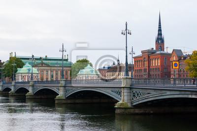 Постер Стокгольм Вид на СтокгольмСтокгольм<br>Постер на холсте или бумаге. Любого нужного вам размера. В раме или без. Подвес в комплекте. Трехслойная надежная упаковка. Доставим в любую точку России. Вам осталось только повесить картину на стену!<br>
