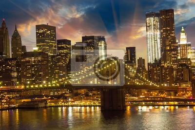 Постер Нью-Йорк Бруклинский Мост и Нижний Манхэттен на ЗакатеНью-Йорк<br>Постер на холсте или бумаге. Любого нужного вам размера. В раме или без. Подвес в комплекте. Трехслойная надежная упаковка. Доставим в любую точку России. Вам осталось только повесить картину на стену!<br>