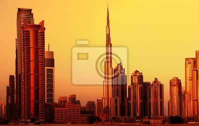Постер Дубай Dubai downtown на закатДубай<br>Постер на холсте или бумаге. Любого нужного вам размера. В раме или без. Подвес в комплекте. Трехслойная надежная упаковка. Доставим в любую точку России. Вам осталось только повесить картину на стену!<br>