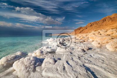 Постер Пейзаж горный Вид Мертвого Моря побережье на закате времениПейзаж горный<br>Постер на холсте или бумаге. Любого нужного вам размера. В раме или без. Подвес в комплекте. Трехслойная надежная упаковка. Доставим в любую точку России. Вам осталось только повесить картину на стену!<br>