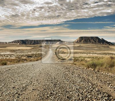 Постер Пейзаж песчаный Дикий Запад дорогаПейзаж песчаный<br>Постер на холсте или бумаге. Любого нужного вам размера. В раме или без. Подвес в комплекте. Трехслойная надежная упаковка. Доставим в любую точку России. Вам осталось только повесить картину на стену!<br>