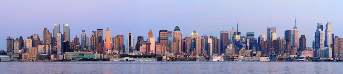 Постер Нью-Йорк Городской Город панорама на закатеНью-Йорк<br>Постер на холсте или бумаге. Любого нужного вам размера. В раме или без. Подвес в комплекте. Трехслойная надежная упаковка. Доставим в любую точку России. Вам осталось только повесить картину на стену!<br>