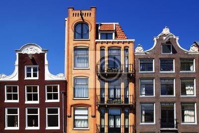 Постер Амстердам Традиционные дома АмстердамаАмстердам<br>Постер на холсте или бумаге. Любого нужного вам размера. В раме или без. Подвес в комплекте. Трехслойная надежная упаковка. Доставим в любую точку России. Вам осталось только повесить картину на стену!<br>
