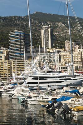 Постер Монако Яхты, пришвартованные в МонакоМонако<br>Постер на холсте или бумаге. Любого нужного вам размера. В раме или без. Подвес в комплекте. Трехслойная надежная упаковка. Доставим в любую точку России. Вам осталось только повесить картину на стену!<br>