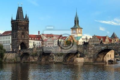 Постер Прага Карлов Мост в Праге в конце летний деньПрага<br>Постер на холсте или бумаге. Любого нужного вам размера. В раме или без. Подвес в комплекте. Трехслойная надежная упаковка. Доставим в любую точку России. Вам осталось только повесить картину на стену!<br>