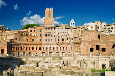 Постер Рим На форуме Траяна в Риме, ИталияРим<br>Постер на холсте или бумаге. Любого нужного вам размера. В раме или без. Подвес в комплекте. Трехслойная надежная упаковка. Доставим в любую точку России. Вам осталось только повесить картину на стену!<br>