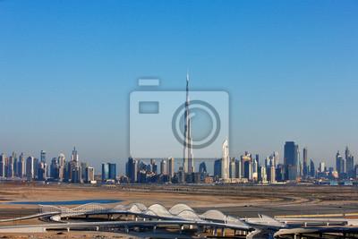 Постер Дубай Горизонт видом на Дубай с его многочисленными skyscapersДубай<br>Постер на холсте или бумаге. Любого нужного вам размера. В раме или без. Подвес в комплекте. Трехслойная надежная упаковка. Доставим в любую точку России. Вам осталось только повесить картину на стену!<br>