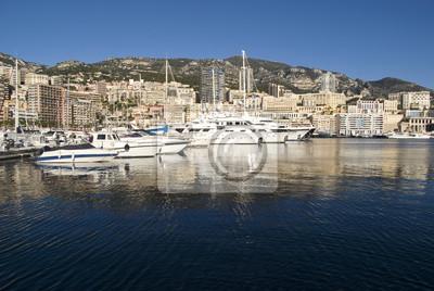 Постер Монако Порт Геркулес в княжестве МонакоМонако<br>Постер на холсте или бумаге. Любого нужного вам размера. В раме или без. Подвес в комплекте. Трехслойная надежная упаковка. Доставим в любую точку России. Вам осталось только повесить картину на стену!<br>