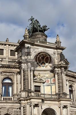 Постер Дрезден Фрагмент здания семпер оперы в ДрезденеДрезден<br>Постер на холсте или бумаге. Любого нужного вам размера. В раме или без. Подвес в комплекте. Трехслойная надежная упаковка. Доставим в любую точку России. Вам осталось только повесить картину на стену!<br>