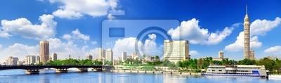Постер Египет Панорама на Каир, набережной Реки Нил.Египет<br>Постер на холсте или бумаге. Любого нужного вам размера. В раме или без. Подвес в комплекте. Трехслойная надежная упаковка. Доставим в любую точку России. Вам осталось только повесить картину на стену!<br>