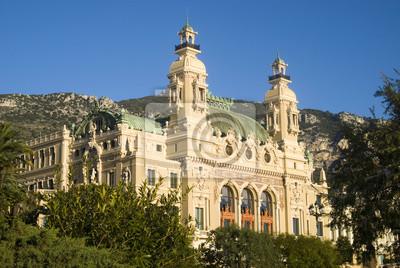 Постер Монако Фасад зал Гарнье, дом оперы Монте-КарлоМонако<br>Постер на холсте или бумаге. Любого нужного вам размера. В раме или без. Подвес в комплекте. Трехслойная надежная упаковка. Доставим в любую точку России. Вам осталось только повесить картину на стену!<br>