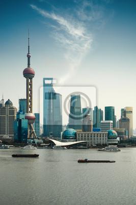 Постер Шанхай Shanghai pudong на фоне голубого небаШанхай<br>Постер на холсте или бумаге. Любого нужного вам размера. В раме или без. Подвес в комплекте. Трехслойная надежная упаковка. Доставим в любую точку России. Вам осталось только повесить картину на стену!<br>
