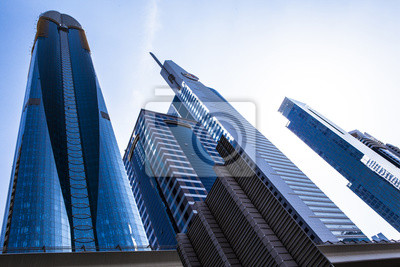 Постер Дубай Высокое здание небоскребаДубай<br>Постер на холсте или бумаге. Любого нужного вам размера. В раме или без. Подвес в комплекте. Трехслойная надежная упаковка. Доставим в любую точку России. Вам осталось только повесить картину на стену!<br>