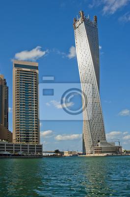 Постер Дубай Infinity Tower, Дубай, Объединенные Арабские ЭмиратыДубай<br>Постер на холсте или бумаге. Любого нужного вам размера. В раме или без. Подвес в комплекте. Трехслойная надежная упаковка. Доставим в любую точку России. Вам осталось только повесить картину на стену!<br>