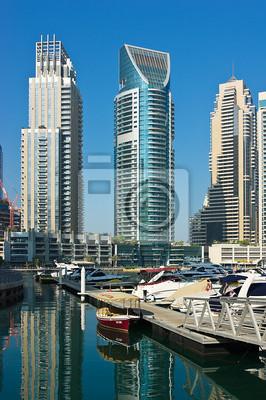Постер Дубай Яхт-Клуб в Дубай Марина, 13 ноября 2012 года, Дубай, ОАЭ.Дубай<br>Постер на холсте или бумаге. Любого нужного вам размера. В раме или без. Подвес в комплекте. Трехслойная надежная упаковка. Доставим в любую точку России. Вам осталось только повесить картину на стену!<br>