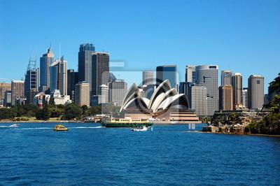 Постер Сидней Вид на Сиднейский Оперный театр. Сидней, АвстралияСидней<br>Постер на холсте или бумаге. Любого нужного вам размера. В раме или без. Подвес в комплекте. Трехслойная надежная упаковка. Доставим в любую точку России. Вам осталось только повесить картину на стену!<br>