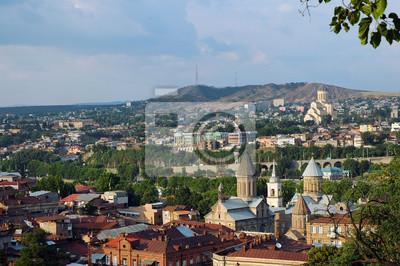 Постер Грузия Панорамный вид на город Тбилиси, ГрузияГрузия<br>Постер на холсте или бумаге. Любого нужного вам размера. В раме или без. Подвес в комплекте. Трехслойная надежная упаковка. Доставим в любую точку России. Вам осталось только повесить картину на стену!<br>