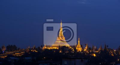 Постер Страны Shwedagon Pagoda, 37x20 см, на бумагеМьянма (Бирма)<br>Постер на холсте или бумаге. Любого нужного вам размера. В раме или без. Подвес в комплекте. Трехслойная надежная упаковка. Доставим в любую точку России. Вам осталось только повесить картину на стену!<br>