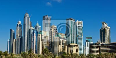 Постер Дубай Современных зданий в Дубай МаринеДубай<br>Постер на холсте или бумаге. Любого нужного вам размера. В раме или без. Подвес в комплекте. Трехслойная надежная упаковка. Доставим в любую точку России. Вам осталось только повесить картину на стену!<br>