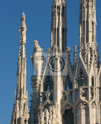Постер Милан Статуи и декор собора Дуомо в МиланеМилан<br>Постер на холсте или бумаге. Любого нужного вам размера. В раме или без. Подвес в комплекте. Трехслойная надежная упаковка. Доставим в любую точку России. Вам осталось только повесить картину на стену!<br>