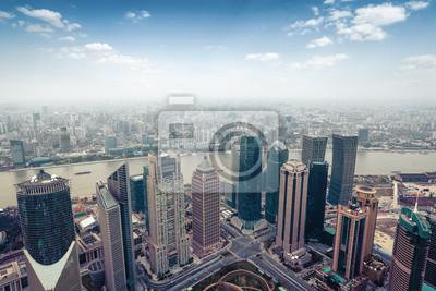 Постер Шанхай Вид с воздуха Шанхая в дневное времяШанхай<br>Постер на холсте или бумаге. Любого нужного вам размера. В раме или без. Подвес в комплекте. Трехслойная надежная упаковка. Доставим в любую точку России. Вам осталось только повесить картину на стену!<br>