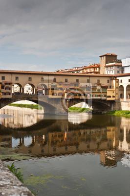 Постер Флоренция Ponte Veccio над рекой Арно, в Флоренция, ИталияФлоренция<br>Постер на холсте или бумаге. Любого нужного вам размера. В раме или без. Подвес в комплекте. Трехслойная надежная упаковка. Доставим в любую точку России. Вам осталось только повесить картину на стену!<br>