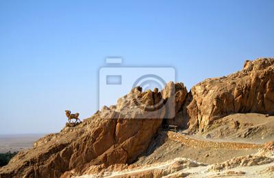 Постер Африканский пейзаж Каньоны, ТунисАфриканский пейзаж<br>Постер на холсте или бумаге. Любого нужного вам размера. В раме или без. Подвес в комплекте. Трехслойная надежная упаковка. Доставим в любую точку России. Вам осталось только повесить картину на стену!<br>