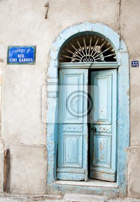Постер Тунис Деревянная Дверь ТунисаТунис<br>Постер на холсте или бумаге. Любого нужного вам размера. В раме или без. Подвес в комплекте. Трехслойная надежная упаковка. Доставим в любую точку России. Вам осталось только повесить картину на стену!<br>
