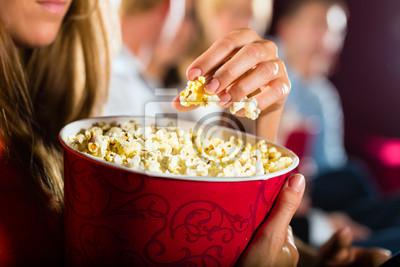 Постер Кино Девочка ест попкорн в кино или театр киноКино<br>Постер на холсте или бумаге. Любого нужного вам размера. В раме или без. Подвес в комплекте. Трехслойная надежная упаковка. Доставим в любую точку России. Вам осталось только повесить картину на стену!<br>
